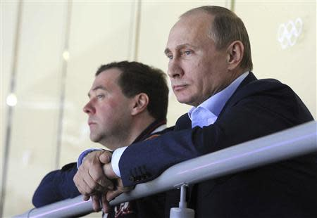 Russian President Putin and PM Medvedev watch Russia's national ice hockey team play Slovakia during the Sochi 2014 Olympic Winter Games at the Bolshoy Ice Dome