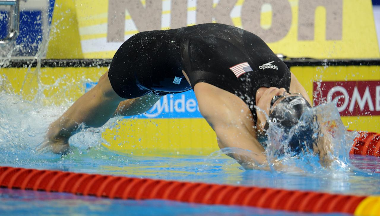 US swimmer Natalie Coughlin dives as she competes in the final of the women's 100-metre backstroke swimming event in the FINA World Championships at the indoor stadium of the Oriental Sports Center in Shanghai on July 26, 2011. She won bronze.  AFP PHOTO / PETER PARKS (Photo credit should read PETER PARKS/AFP/Getty Images)