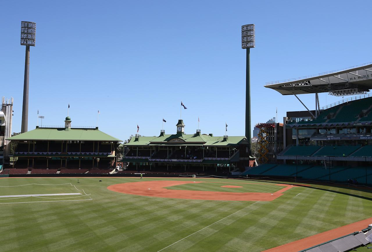 Ground staff prepare the baseball field that has been especially built for the Major League Baseball opening series at the Sydney Cricket Ground in Sydney, Monday, March 17, 2014. The MLB season-opening two-game series between the Los Angeles Dodgers and Arizona Diamondbacks in Sydney will be played this weekend. (AP Photo/Rick Rycroft)