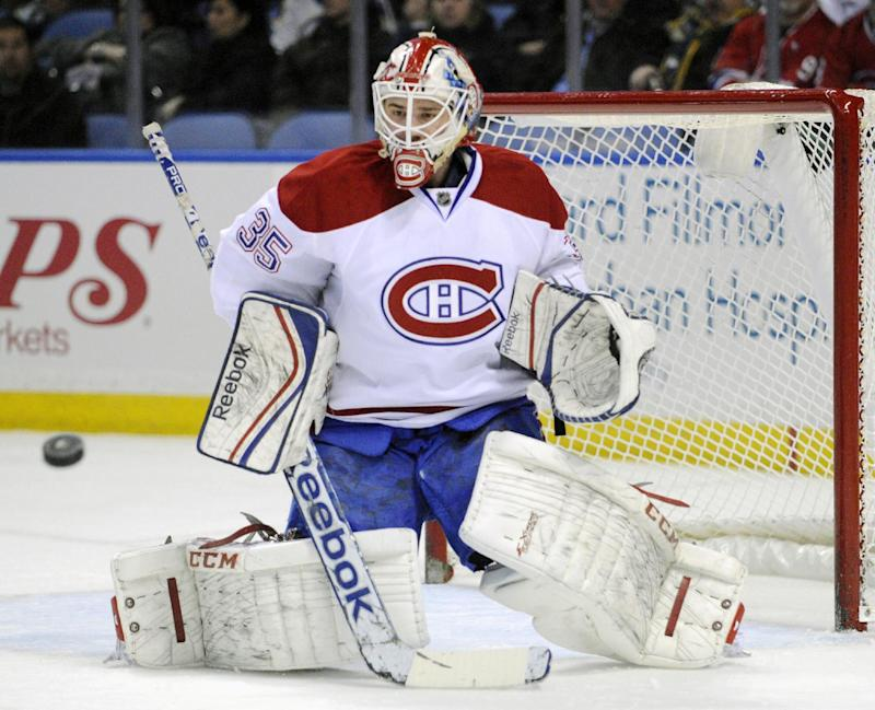 Montreal Canadiens goaltender Dustin Tokarski makes a save during the first period of an NHL hockey game against the Buffalo Sabres in Buffalo, N.Y., Sunday, March 16, 2014