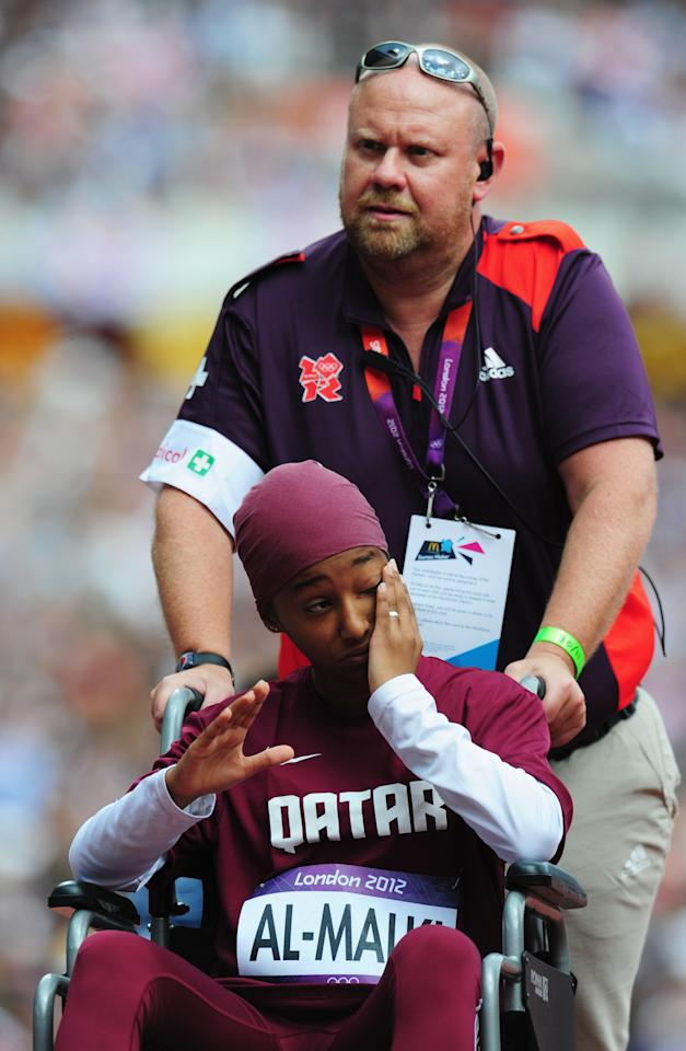 LONDON, ENGLAND - AUGUST 03:  Noor Hussain Al-Malki of Qatar is wheeled away injured in the Women's 100m Heats on Day 7 of the London 2012 Olympic Games at Olympic Stadium on August 3, 2012 in London, England.  (Photo by Stu Forster/Getty Images)