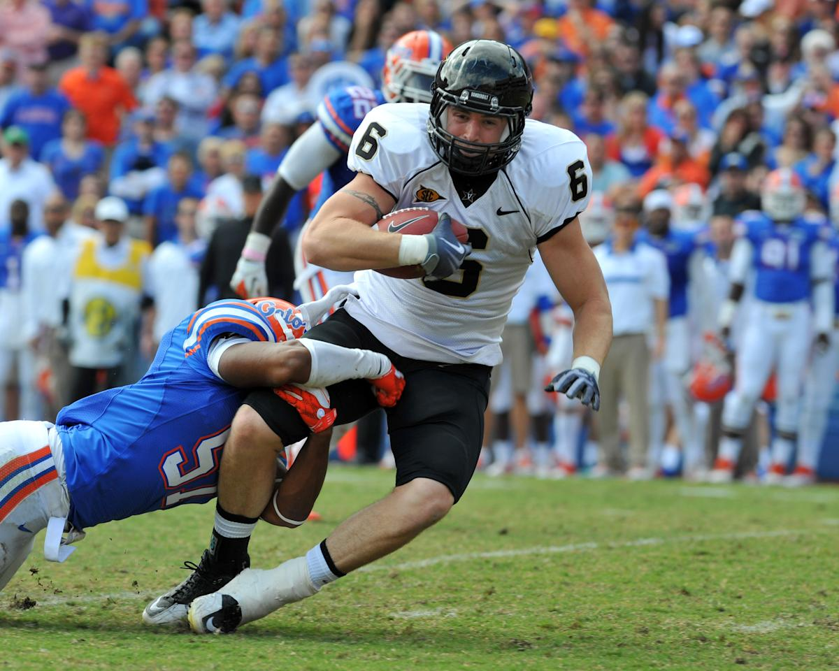 GAINESVILLE, FL -  NOVEMBER 5:  Tight end Brandon Barden #6 of the Vanderbilt Commodores crosses midfield with a pass against the Florida Gators November 5, 2011 at Ben Hill Griffin Stadium in Gainesville, Florida.  (Photo by Al Messerschmidt/Getty Images)