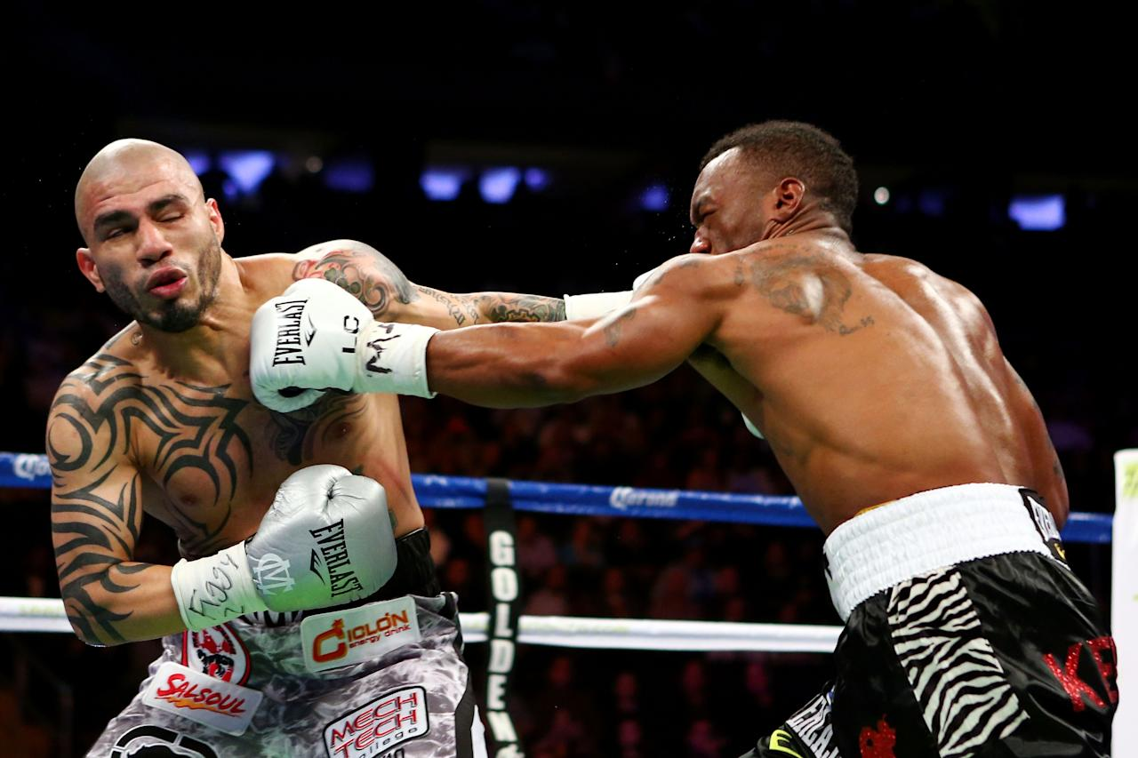 NEW YORK, NY - DECEMBER 01:  Austin Trout (R) connects on a punch to the face of fights Miguel Cotto in their WBA Super Welterweight Championship title fight at Madison Square Garden on December 1, 2012 in New York City.  (Photo by Elsa/Getty Images)