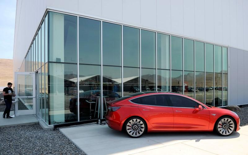 Tesla loss widens as company works to speed production