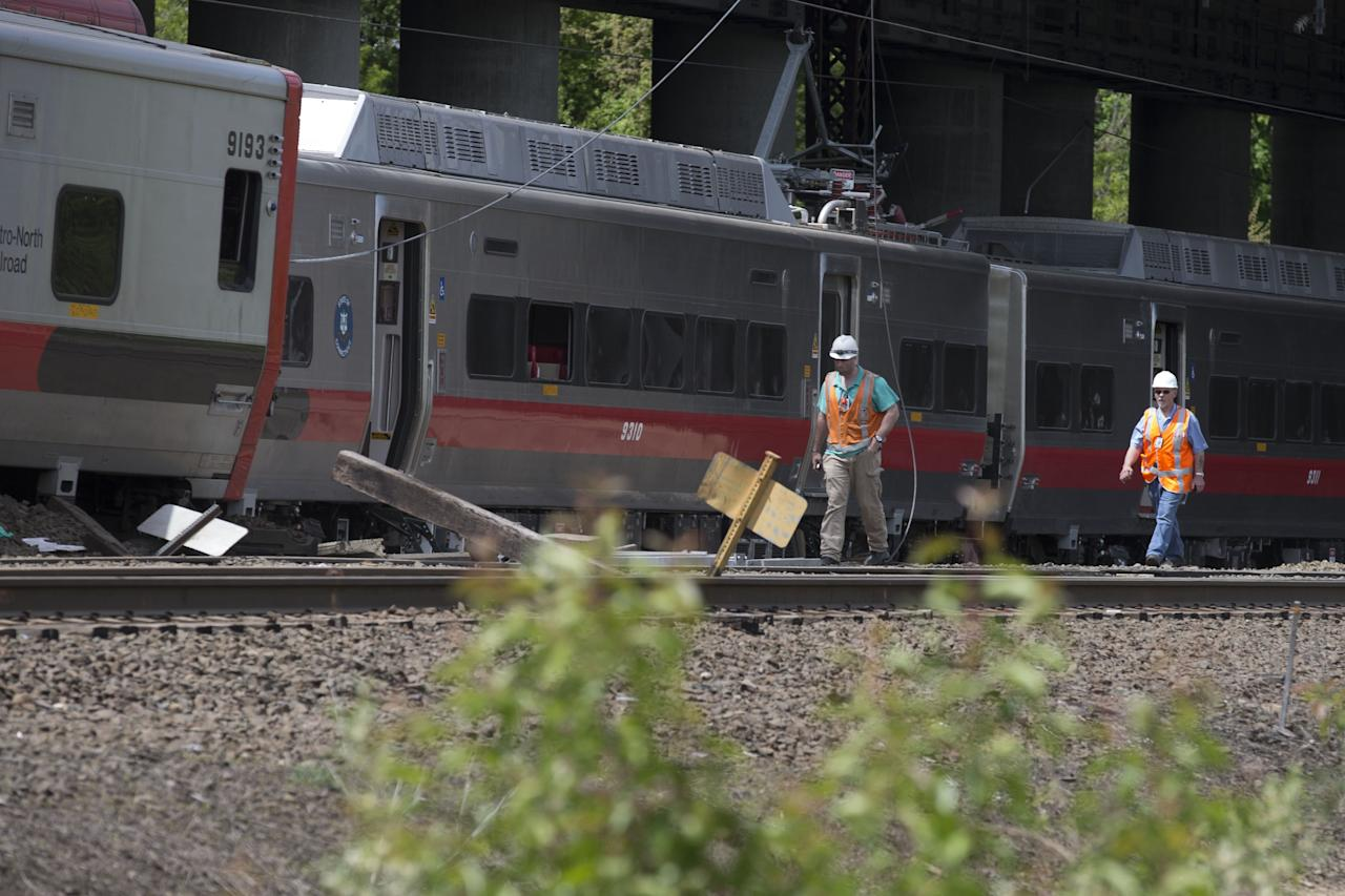 FAIRFIELD, CT - MAY 18: Connecticut state investigators examines the scene of a Metro North train collision on May 18, 2013 in Fairfield, Connecticut.  Two New Haven Line Metro North commuter trains collided on Friday, May 17 near Bridgeport, CT, injuring as many as 70 people.  (Photo by Michael Graae/Getty Images)