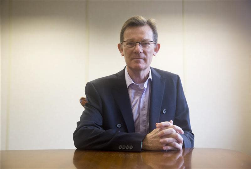 Geoff Cooper, the CEO of building supplier Travis Perkins poses for a portrait in London