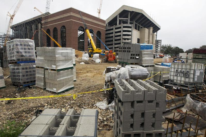 Construction material sits outside as a crew worka on the redevelopment of Kyle Field in College Station, Texas, Thursday, March 27, 2014