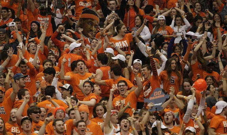Syracuse fans celebrate after the team defeated Duke in an NCAA college basketball game in Syracuse, N.Y., Saturday, Feb. 1, 2014. Syracuse won 91-89