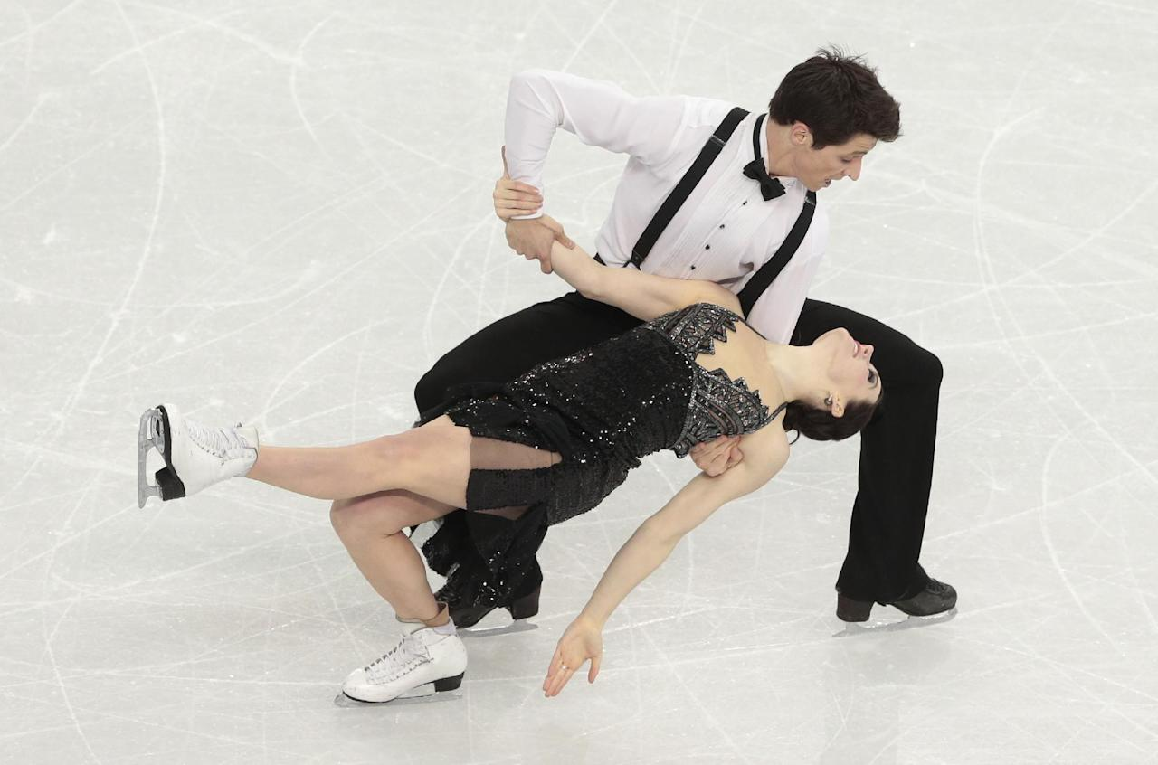 Tessa Virtue and Scott Moir of Canada compete in the ice dance short dance figure skating competition at the Iceberg Skating Palace during the 2014 Winter Olympics, Sunday, Feb. 16, 2014, in Sochi, Russia. (AP Photo/Ivan Sekretarev)