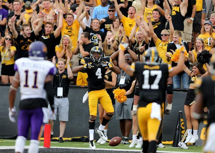 Iowa wide receiver Tevaun Smith, center, celebrates after a touchdown catch during the second half of an NCAA college football game against Northern Iowa, Saturday, Aug. 30, 2014, in Iowa City, Iowa. Iowa won 31-23