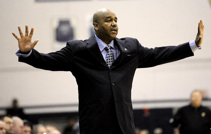 Georgetown head coach John Thompson III gestures during the first half of an NCAA college NIT tournament first round basketball game against West Virginia, Tuesday, March 18, 2014, in Washington. Georgetown won 77-65