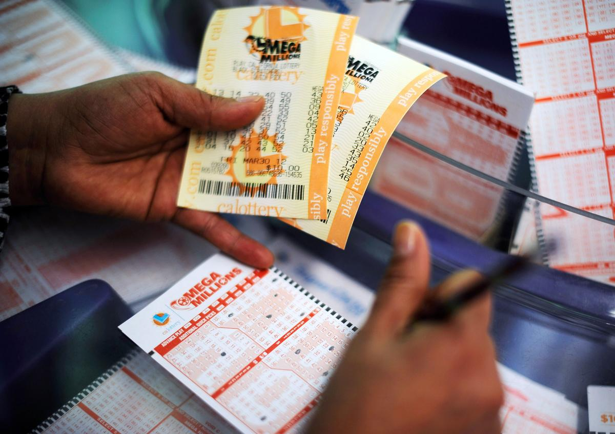 A record $656 million Mega Millions drawing spurred unprecedented sales of lottery tickets in March. The jackpot was split among holders of three winning tickets sold in three different states. (Kevork Djansezian/Getty Images)