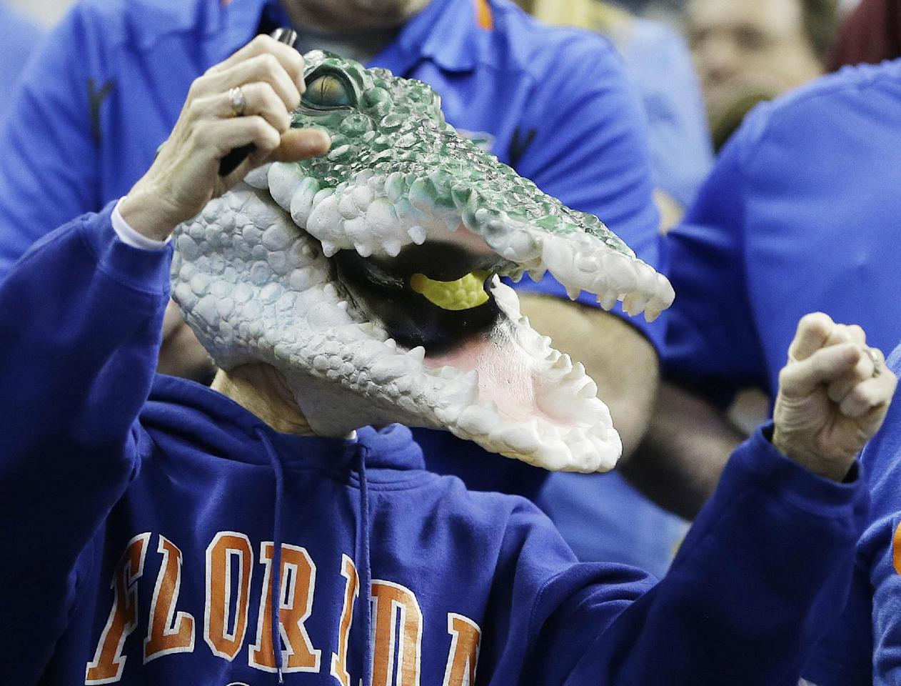 Florida fans cheer before the first half in a regional final game against Dayton at the NCAA college basketball tournament, Saturday, March 29, 2014, in Memphis, Tenn. (AP Photo/Mark Humphrey)