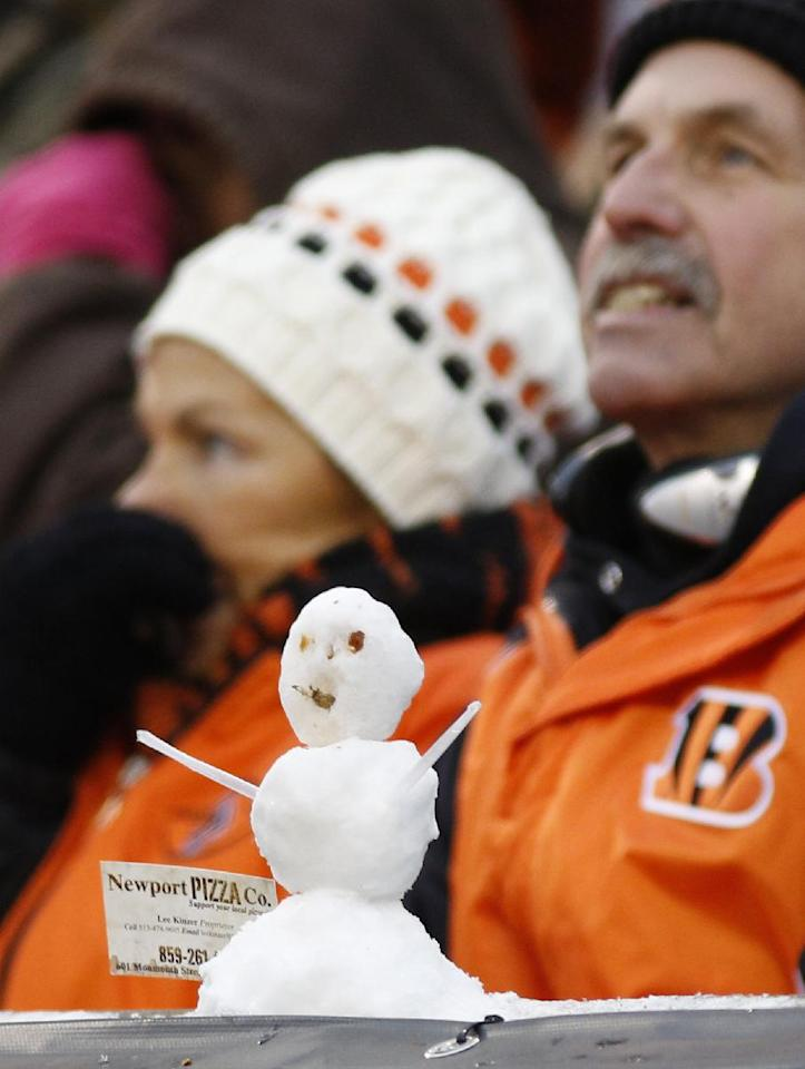 Cincinnati Bengals fans are bundled up behind a snowman in the second half of an NFL football game against the Indianapolis Colts, Sunday, Dec. 8, 2013, in Cincinnati. Cincinnati won 42-28. (AP Photo/David Kohl)