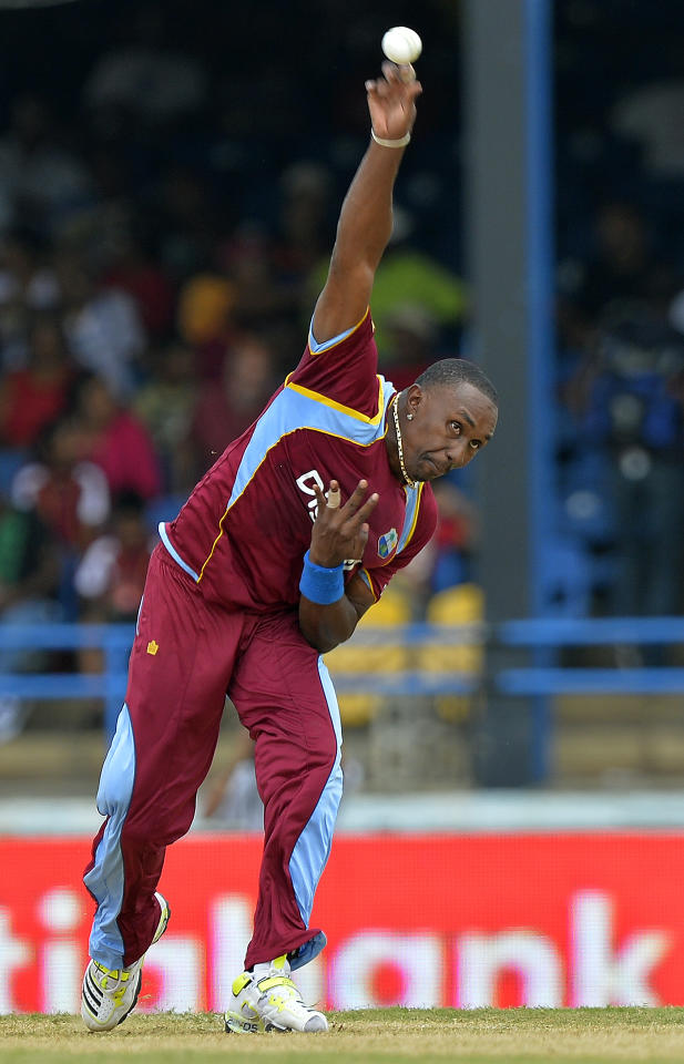 West Indies cricket team captain Dwayne Bravo delivers a ball during the fourth match of the Tri-Nation series between India and West Indies at the Queen's Park Oval in Port of Spain on July 5, 2013. West Indies won the toss and elected to field. AFP PHOTO/Jewel Samad (Photo credit should read JEWEL SAMAD/AFP/Getty Images)