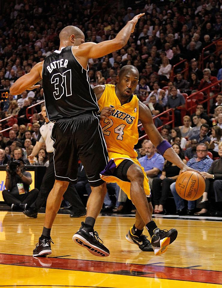 MIAMI, FL - JANUARY 19: Kobe Bryant #24 of the Los Angeles Lakers drives by Shane Battier #31 of the Miami Heat during a game  at American Airlines Arena on January 19, 2012 in Miami, Florida. NOTE TO USER: User expressly acknowledges and agrees that, by downloading and/or using this Photograph, User is consenting to the terms and conditions of the Getty Images License Agreement.  (Photo by Mike Ehrmann/Getty Images)
