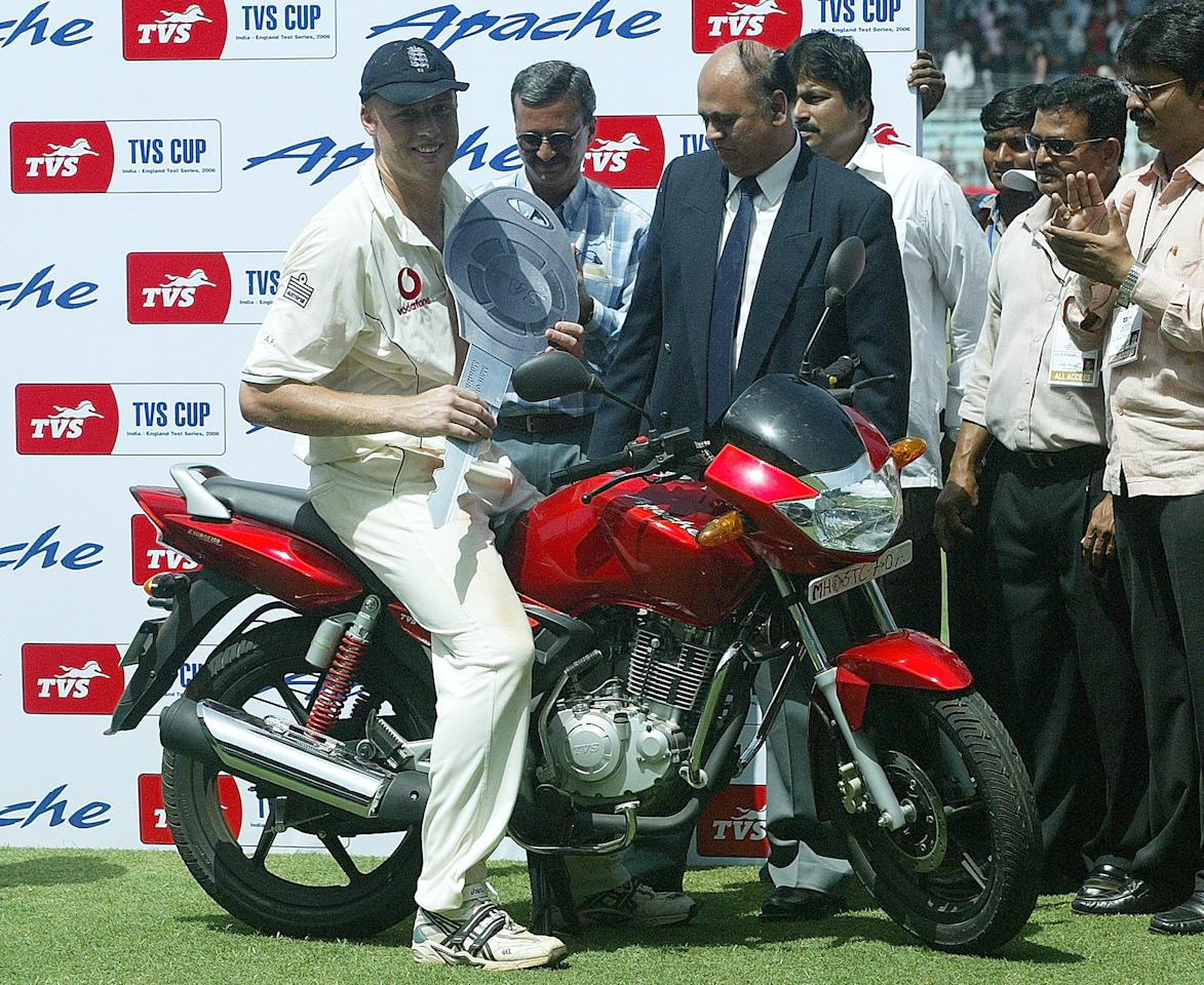 England cricket captain Andrew Flintoff poses on a motorbike, his Man of the Match prize, at the award ceremony at the end of the last day of the third Test match between India and England at the Wankhede Stadium in Mumbai 22 March 2006.  England beat India by 212 runs to square the three-match Test series 1-1.        AFP PHOTO/Indranil MUKHERJEE