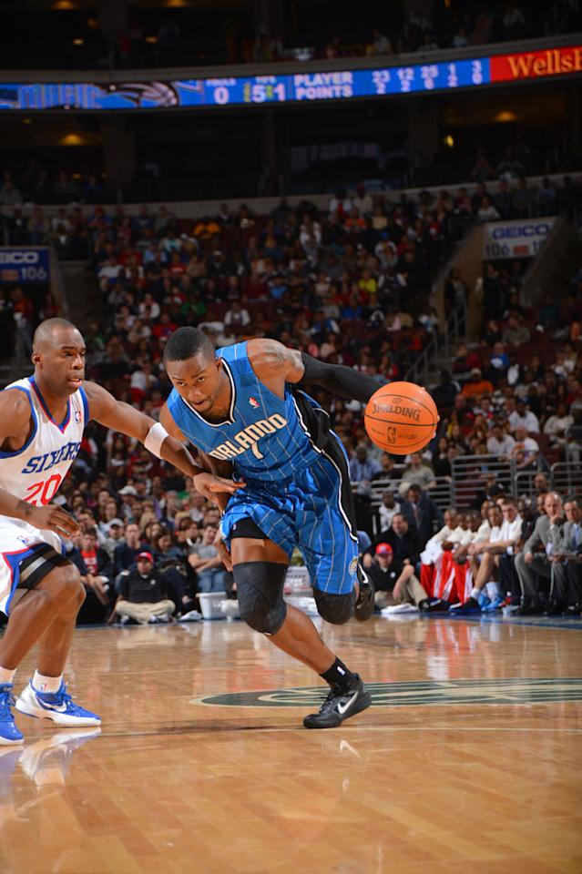 PHILADELPHIA, PA - APRIL 7: Von Wafer #1 of the Orlando Magic drives to the basket against Jodie Meeks #20 of the Philadelphia 76ers on April 7, 2012 at the Wells Fargo Center in Philadelphia, Pennsylvania.    NOTE TO USER: User expressly acknowledges and agrees that, by downloading and/or using this Photograph, user is consenting to the terms and conditions of the Getty Images License Agreement. Mandatory Copyright Notice: Copyright 2012 NBAE