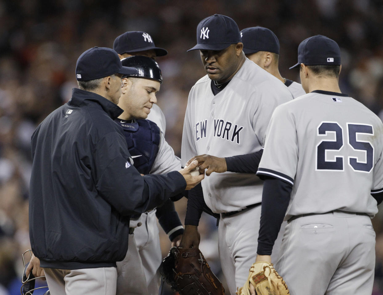 New York Yankees starting pitcher CC Sabathia walks off the mound after being replaced during the sixth inning of Game 3 of baseball's American League division series on Monday, Oct. 3, 2011, in Detroit. At left is manager Joe Girardi. The Tigers defeated the New York Yankees 5-4. (AP Photo/Paul Sancya)