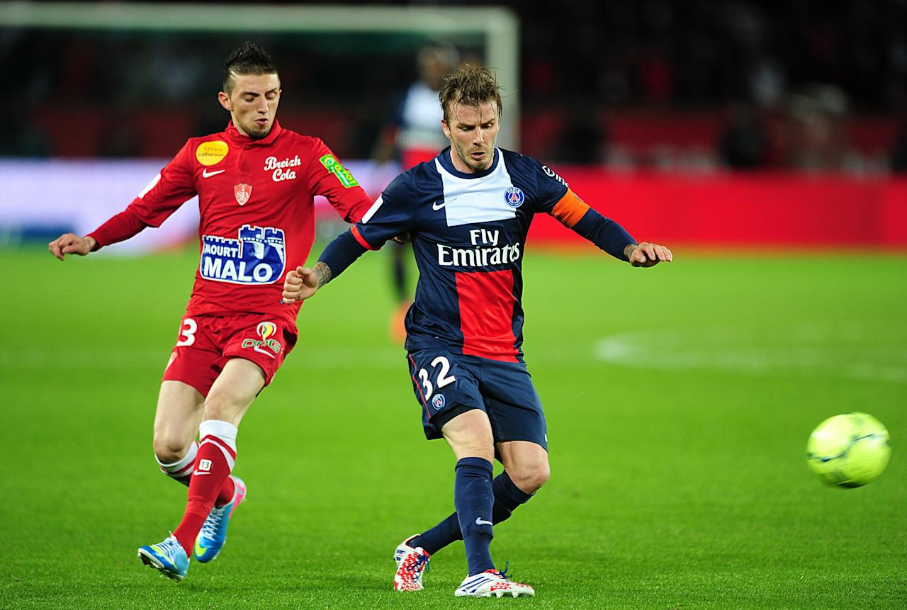 Paris Saint-Germain's David Beckham (right) comes under pressure from Stade Brestois' Abel Khaled