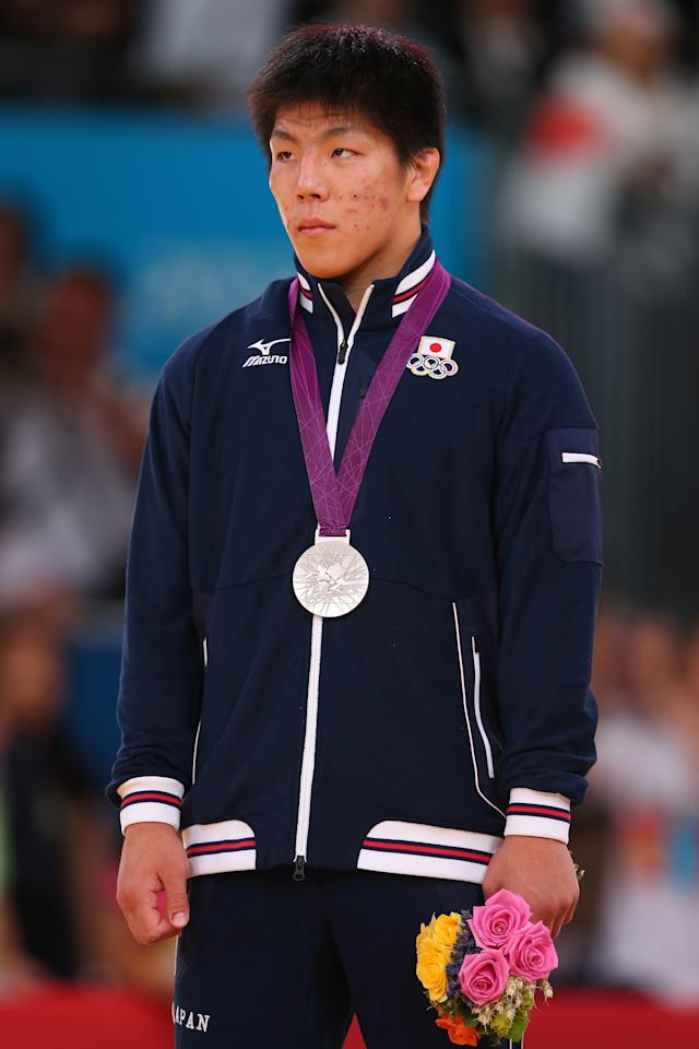 LONDON, ENGLAND - JULY 30:  Silver medalist Riki Nakaya of Japan pose on the medal stand during the Men's -73 kg Judo on Day 3 of the London 2012 Olympic Games at ExCeL on July 30, 2012 in London, England.  (Photo by Alexander Hassenstein/Getty Images)