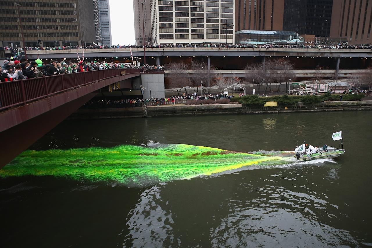 CHICAGO, IL - MARCH 16:  Workers begin dying the Chicago River green to kick off the city's St. Patrick's day celebration on March 16, 2013 in Chicago, Illinois. The dying of the river has been a tradition in the city for 43 years.  (Photo by Scott Olson/Getty Images)