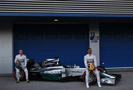 Mercedes Formula One racing driver Hamilton of Britain and teammate Rosberg of Germany unveil the new Mercedes F1 W05 car at the Jerez racetrack in southern Spain