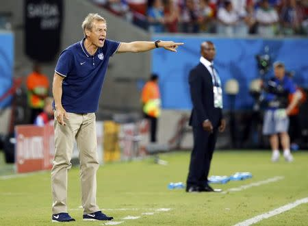 U.S. coach Juergen Klinsmann shouts instructions to his players during their 2014 World Cup Group G soccer match against Ghana at the Dunas arena in Natal