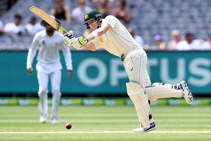 Smith scores century before rain hits MCG again