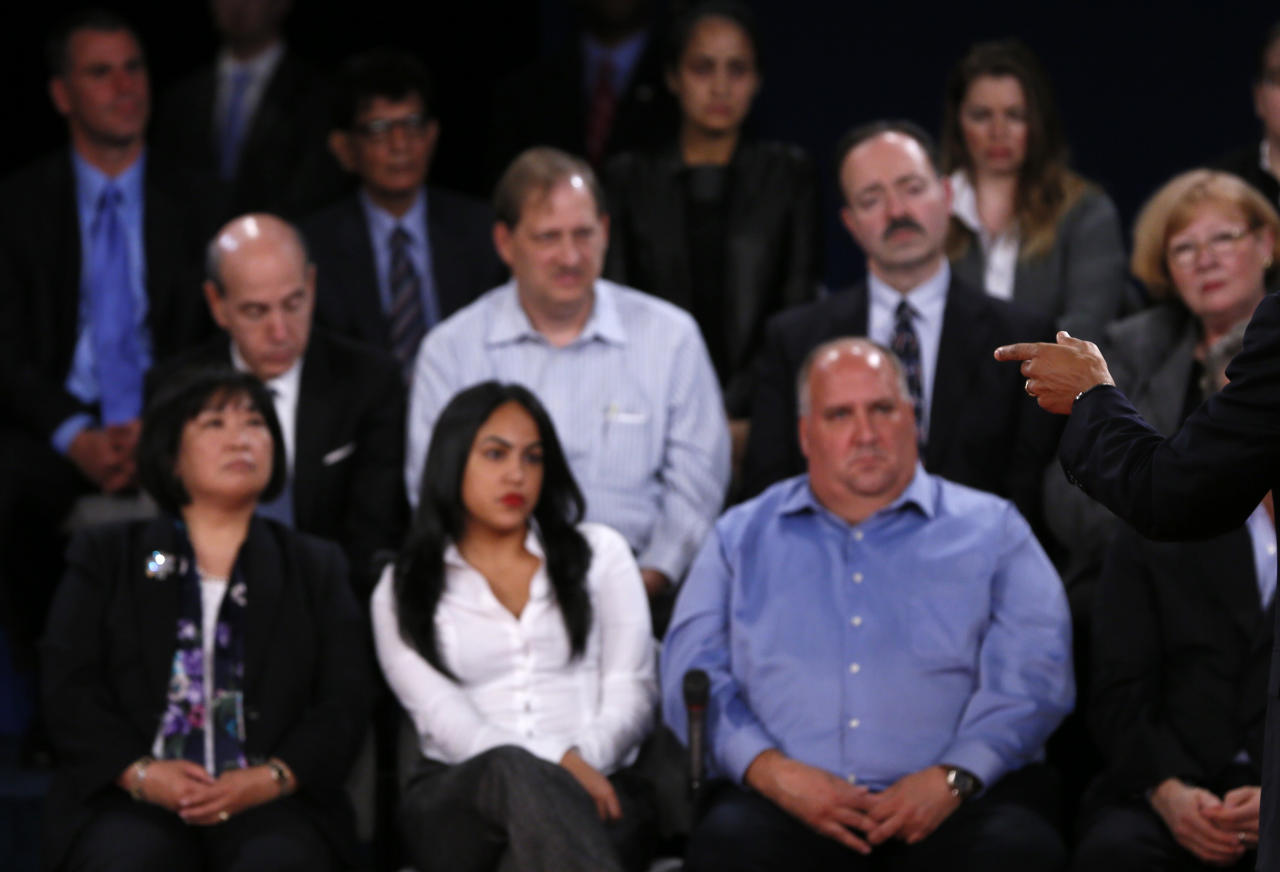 Members of the audience look on as U.S. President Barack Obama (R) speaks as he debates Republican presidential nominee Mitt Romney during the second U.S. presidential debate in Hempstead, New York October 16, 2012.           REUTERS/Shannon Stapleton (UNITED STATES  - Tags: POLITICS ELECTIONS USA PRESIDENTIAL ELECTION)