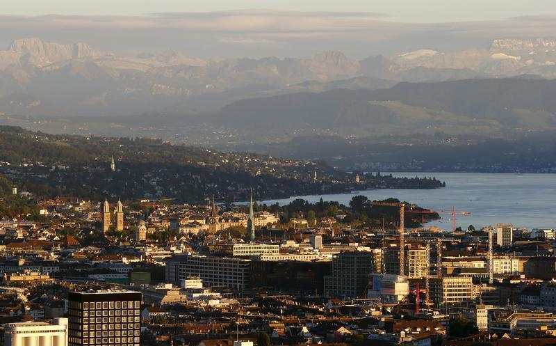 A general view shows the city of Zurich, Lake Zurich and the eastern Swiss Alps