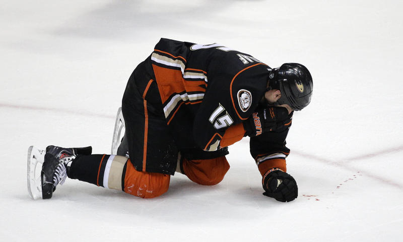Anaheim Ducks' Ryan Getzlaf bleeds after he was hit in the face by a puck during the third period in Game 1 of the first-round NHL hockey Stanley Cup playoff series against the Dallas Stars on Wednesday, April 16, 2014, in Anaheim, Calif. The Ducks won 4-3