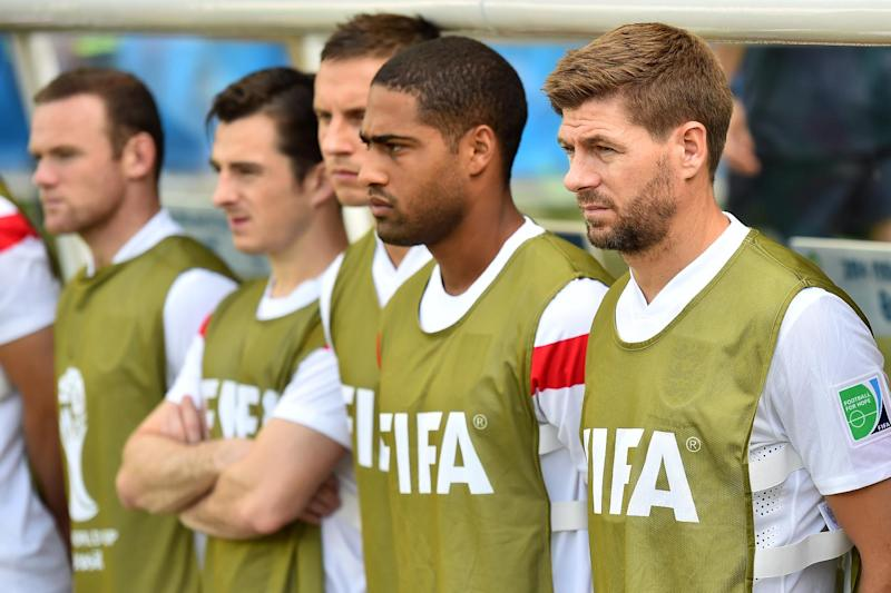 England's captain Steven Gerrard (R) stands with substitutes during their Group D match against Costa Rica, at The Mineirao Stadium in Belo Horizonte, Brazil, during the FIFA World Cup, on June 24, 2014