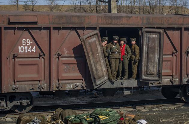 Female soldiers stand in a train car outside of Pyongyang.