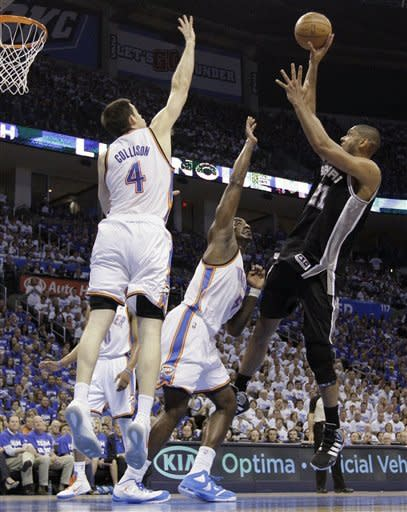 San Antonio Spurs center Tim Duncan (21) shoots over Oklahoma City Thunder's Kendrick Perkins (5) and Nick Collison (4) during the first half of Game 4 in the NBA basketball playoffs Western Conference finals, Saturday, June 2, 2012, in Oklahoma City. (AP Photo/Eric Gay)
