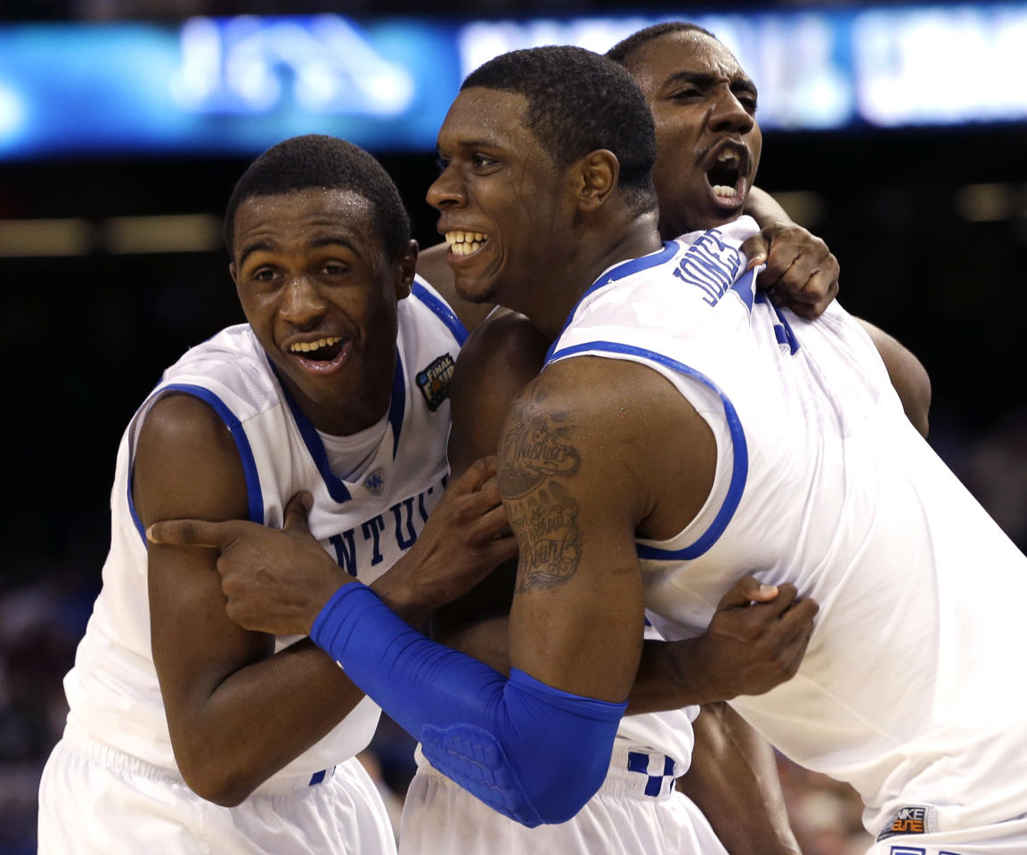Kentucky guard Doron Lamb,left, forward Terrence Jones (3) and guard Marquis Teague celebrate after the NCAA Final Four tournament college basketball championship game Monday, April 2, 2012, in New Orleans. Kentucky won 67-59(AP Photo/David J. Phillip)