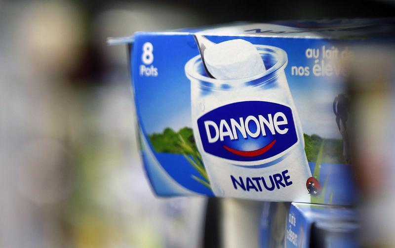 Yoghurt produced by French Dairy Group Danone are displayed on a shelf in an supermarket in Lanton
