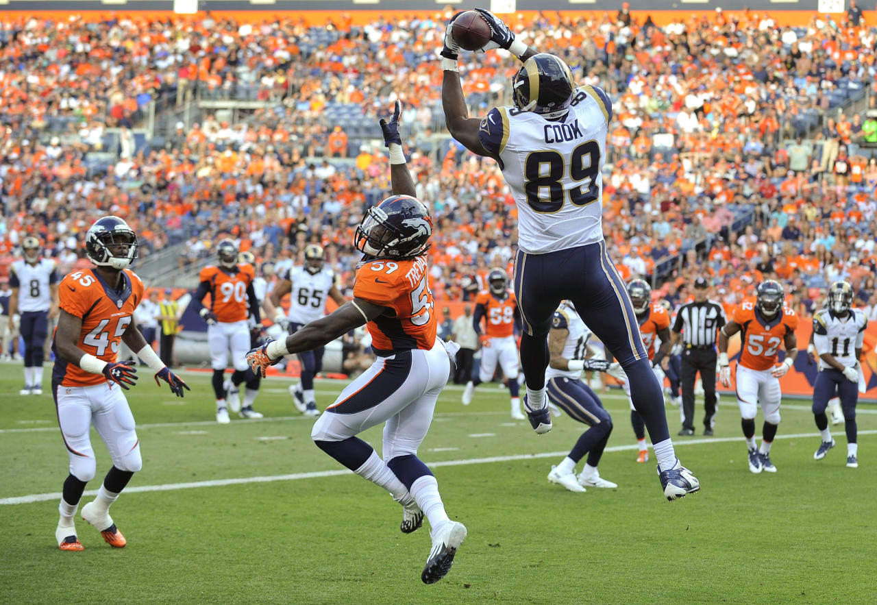 St. Louis Rams tight end Jared Cook (89) catches a pass for a touchdown against Denver Broncos linebacker Danny Trevathan (59) as Denver Broncos cornerback Dominique Rodgers-Cromartie (45) looks on in the first quarter of a preseason NFL football game, Saturday, Aug. 24, 2013, in Denver. (AP Photo/Jack Dempsey)
