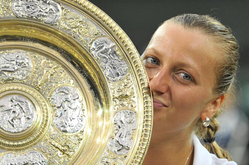 Czech Republic's Petra Kvitova kisses the winner's title after beating Canada's Eugenie Bouchard in the women's singles final on day 12 of the Wimbledon Championships at The All England Tennis Club in southwest London, on July 5, 2014