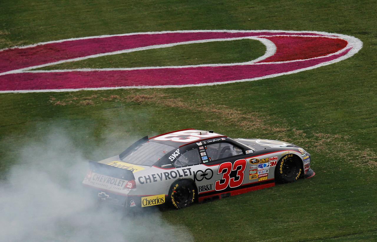 TALLADEGA, AL - OCTOBER 23:  Clint Bowyer, driver of the #33 Chevy 100 Years Chevrolet, performs a burnout after winning the NASCAR Sprint Cup Series Good Sam Club 500 at Talladega Superspeedway on October 23, 2011 in Talladega, Alabama.  (Photo by Kevin C. Cox/Getty Images for NASCAR)