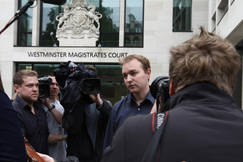 Trader to face trial in rate-rigging case