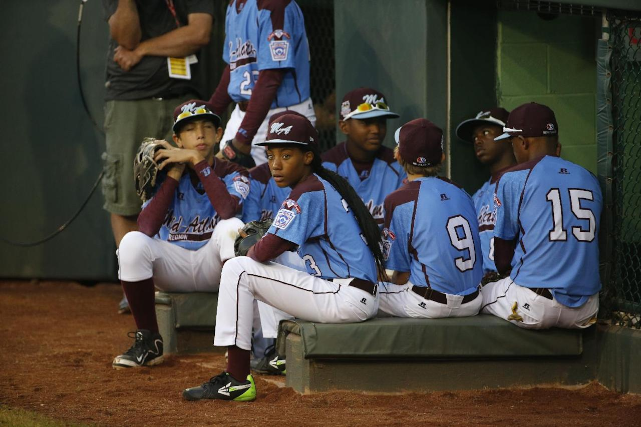 Philadelphia pitcher Mo'ne Davis, center from left, waits to take the field with her teammates for a United States semi-final baseball game against Las Vegas at the Little League World Series tournament in South Williamsport, Pa., Tuesday, Aug. 20, 2014. (AP Photo/Gene J. Puskar)