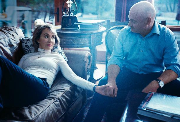 This undated image provided by Vogue shows former Rep. Gabrielle Giffords, D-Ariz., left, with her husband, former astronaut Mark Kelly, during a photo shoot at their home in Tucson, Ariz. The image and accompanying article by John Powers will be published in the March 2013 issue of Vogue, available on newsstands nationwide on Feb. 19. (AP Photo/Norman Jean Roy for Vogue)