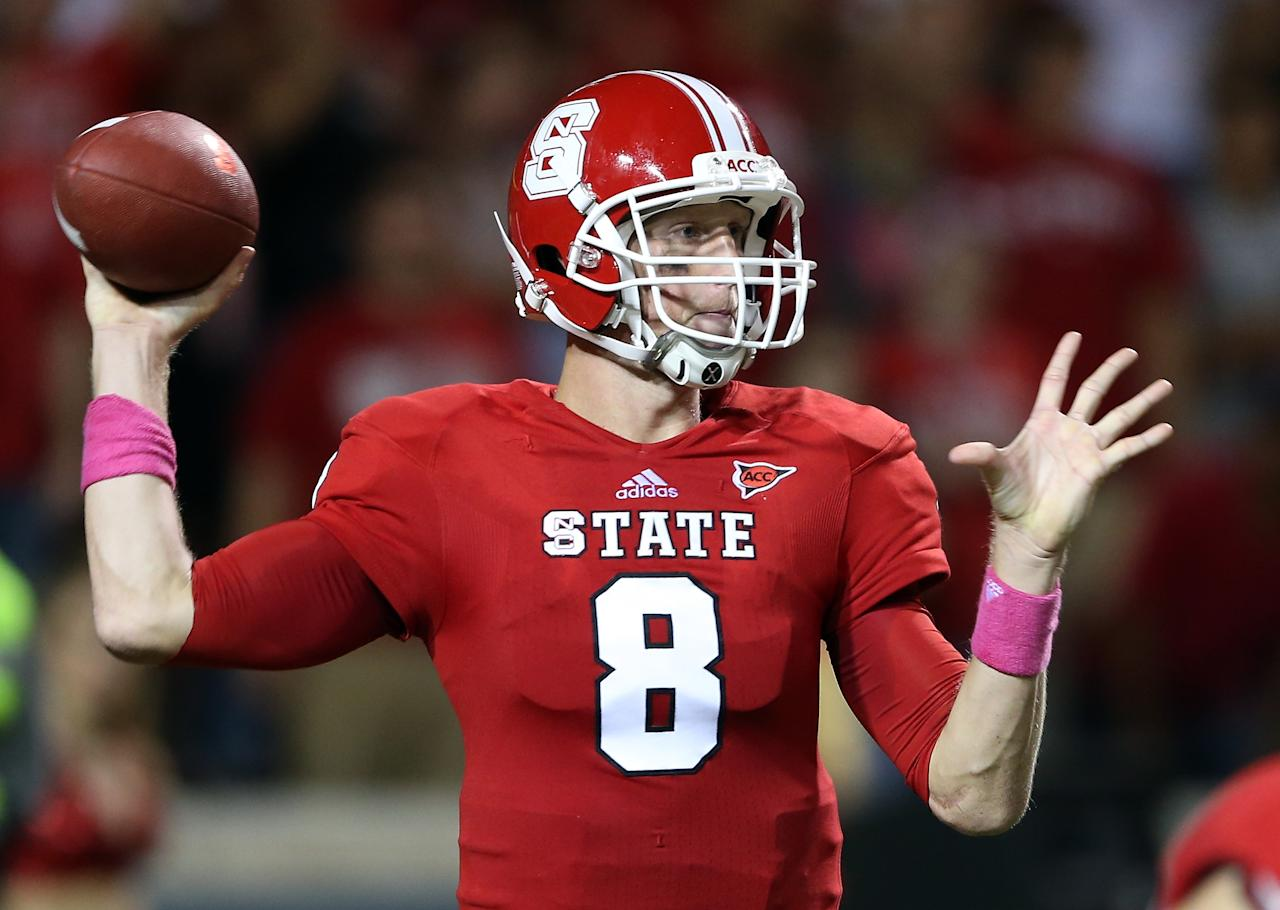 RALEIGH, NC - OCTOBER 06:  Mike Glennon #8 of the North Carolina State Wolfpack drops back to pass against the Florida State Seminoles during their game at Carter-Finley Stadium on October 6, 2012 in Raleigh, North Carolina.  (Photo by Streeter Lecka/Getty Images)
