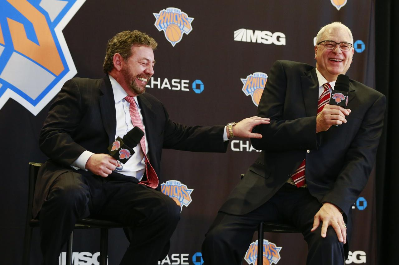 Phil Jackson (R) and New York Knicks owner James Dolan laugh during a news conference announcing Jackson as the team president of the New York Knicks basketball team at Madison Square Garden in New York March 18, 2014.REUTERS/Shannon Stapleton (UNITED STATES - Tags: SPORT BASKETBALL BUSINESS)