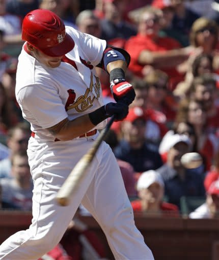 St. Louis Cardinals' Yadier Molina (4) connects for a two-RBI single in the fourth inning of a baseball game against the Chicago Cubs, Saturday, April 14, 2012, in St. Louis.(AP Photo/Tom Gannam)