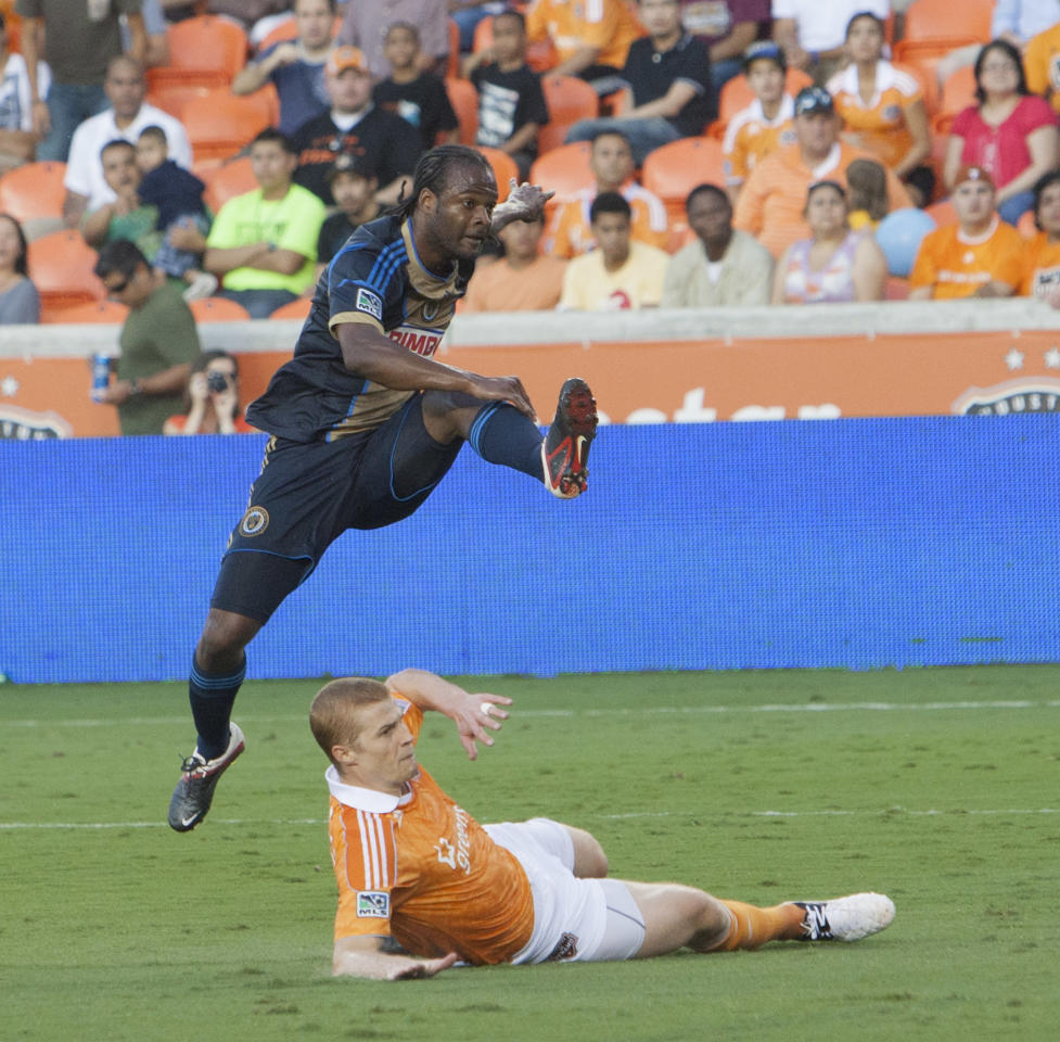 HOUSTON, TX - JUNE 30: Jorge Perlaza #16 of the Philadelphia Union shoots over a block attempt by Andre Hainault #31 of the Houston Dynamo at BBVA Compass Stadium on June 30, 2012 in Houston, Texas. (Photo by Bob Levey/Getty Images)