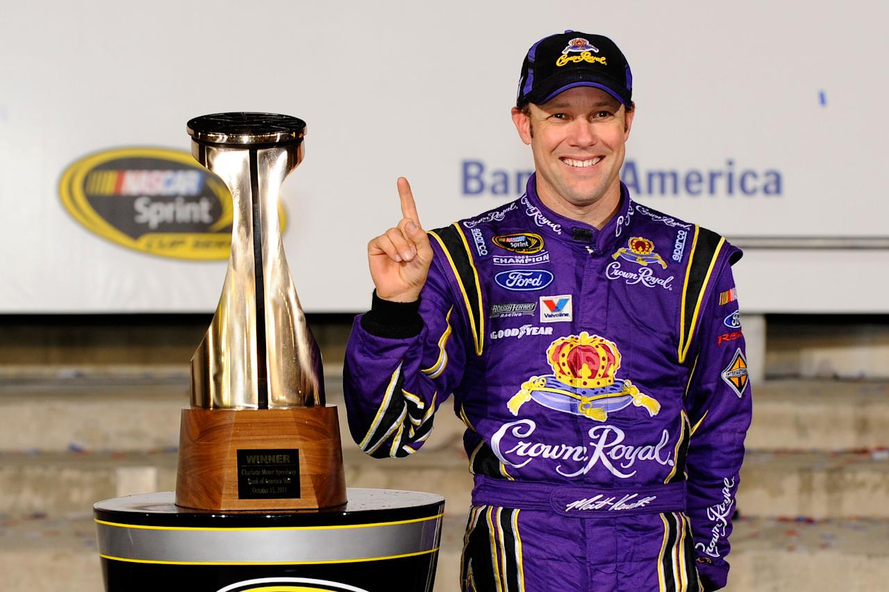 CHARLOTTE, NC - OCTOBER 15:  Matt Kenseth, driver of the #17 Fluidmaster Ford, poses in Victory Lane after winning the NASCAR Sprint Cup Series Bank of America 500 at Charlotte Motor Speedway on October 15, 2011 in Charlotte, North Carolina.  (Photo by Jason Smith/Getty Images for NASCAR)