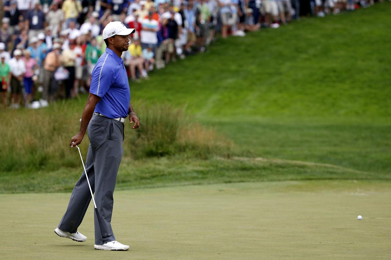ARDMORE, PA - JUNE 13: Tiger Woods of the United States reacts to his putt on the fourth green during Round One of the 113th U.S. Open at Merion Golf Club on June 13, 2013 in Ardmore, Pennsylvania. (Photo by Rob Carr/Getty Images)