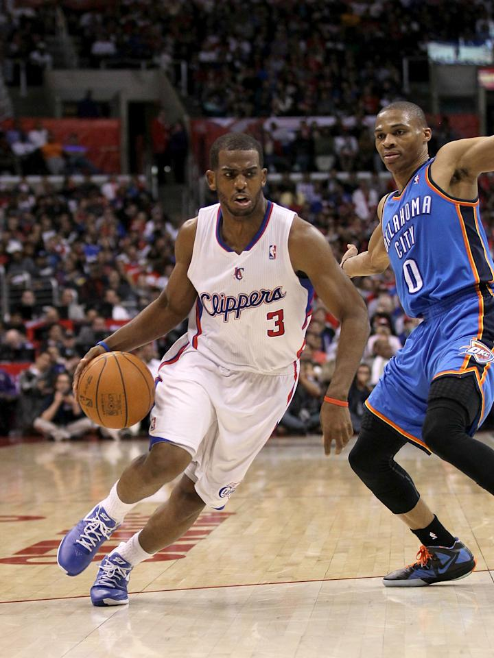 LOS ANGELES, CA - APRIL 16:  Chris Paul #3 of the Los Angeles Clippers drives around Russell Westbrook #0 of the Oklahoma City Thunder at Staples Center on April 16, 2012 in Los Angeles, California.  The Clippers won 92-77.  NOTE TO USER: User expressly acknowledges and agrees that, by downloading and or using this photograph, User is consenting to the terms and conditions of the Getty Images License Agreement.  (Photo by Stephen Dunn/Getty Images)